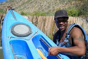 This is Cameron, one of our guides. He is getting the kayaks over the diversion dam.