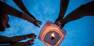 Lighting a paper lantern in the air